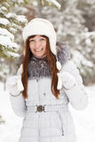 Girl in wintry pine  forest Royalty Free Stock Photos