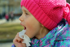Girl wipes. One's dirty face by facial tissue outdoor Stock Image