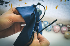 Girl wipes glasses with napkin Stock Image