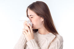 Girl wipes her nose kerchief closing your eyes is isolated on a white background. Girl wipes her nose kerchief closing your eyes is isolated on a white Stock Images