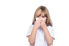 The girl wipes a nose a handkerchief Stock Photo