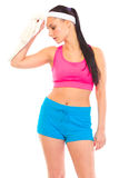 Girl wiping face with towel after exercising Stock Images