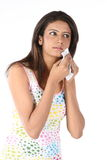 Girl wiping her face with tissue paper Royalty Free Stock Images