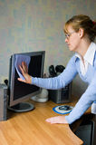 The girl wiping the monitor Stock Photography