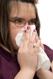 Girl Wiping Nose. Closeup view of a young girl wiping her runny nose Royalty Free Stock Images