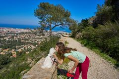 Girl wirh pet dog looking at Denia aerial view royalty free stock photography