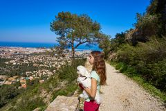Girl wirh pet dog looking at Denia aerial view. In alicante of Spain royalty free stock photography