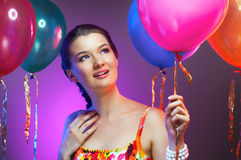 Girl wit balloons Stock Images