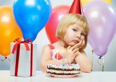 Girl wit balloons. Little beauty girl celebrates birthday Stock Photos