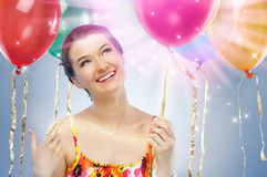 Girl wit balloons Stock Image
