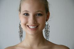 Girl wit earrings Stock Image