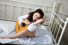 Girl wit guitar. Portrait of young beauty girl with guitar Royalty Free Stock Image