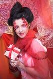 Girl wit present box Royalty Free Stock Photo