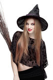 Girl in witch costume with a broom Royalty Free Stock Photo