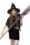 Girl in witch costume with a broom. 2 stock photos