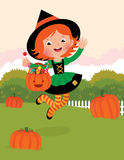 Girl in witch costume celebrates Halloween Stock Photo