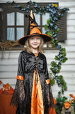 Girl in witch costume Stock Photos