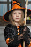 Girl in witch costume. Charming little witch with hat Royalty Free Stock Photo