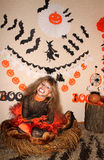Girl in witch costume stock images