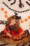Girl in witch costume Stock Photography