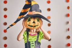 Girl in witch costume Royalty Free Stock Photos