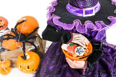 Girl in a Witch Dress with Halloween Accessories and full Bucket