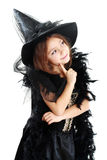 Girl in witch halloween costume Royalty Free Stock Photography