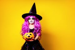 Girl in witch Halloween costume stock image
