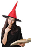 Girl with a witch hat Royalty Free Stock Image