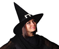 Girl with a witch hat smiling. Portrait of a smiling teenager girl, with a witch hat royalty free stock image
