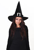 Girl with a witch hat smiling. Portrait of a smiling teenager girl, with a witch hat stock images