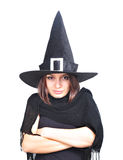 Girl with a witch hat smiling. Portrait of a smiling teenager girl, with a witch hat Royalty Free Stock Photo