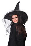 Girl with a witch hat smiling. Portrait of a smiling teenager girl, with a witch hat stock photography
