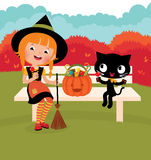Girl witch with her   cat celebrate Halloween Royalty Free Stock Images