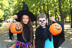Girl witch and little boy Royalty Free Stock Images