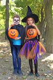 Girl witch and little boy Royalty Free Stock Image