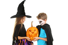 Girl witch and little boy Stock Photos