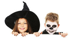 Girl witch and little boy Stock Images
