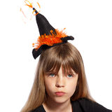 Girl with witches hat Stock Images