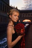 Girl With A Boquet Of Roses Royalty Free Stock Image