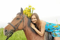 Girl With A Bouquet Of Irises On A Horse Stock Image