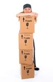 Girl With A Stack Of Cardboard Boxes Stock Image