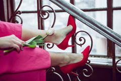 Free Girl With A Tulip On The Stairs 2 Royalty Free Stock Photo - 140919265