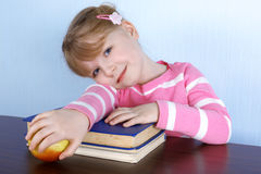 Girl With Apple And Books Stock Photos