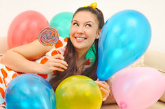 Girl With Balloons And Bonbon Stock Image