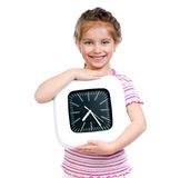 Girl With Big Clock Royalty Free Stock Photography