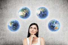 Free Girl With Black Hair And Four Globes On Concrete Wall Royalty Free Stock Image - 78202866