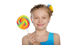Girl With Bow And Candy Royalty Free Stock Photo