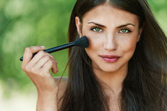 Girl With Brush For Makeup Royalty Free Stock Images