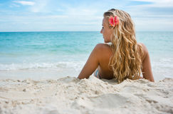 Girl With Flower On The Beach Stock Image